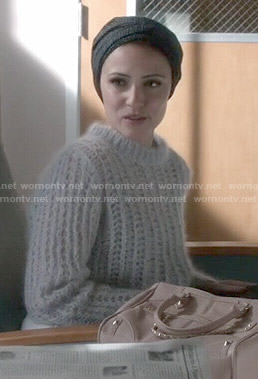 April's grey fluffy sweater on Chasing Life
