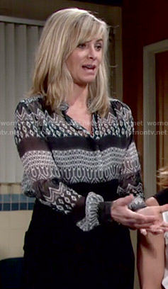 Ashley's green mixed print blouse on The Young and the Restless