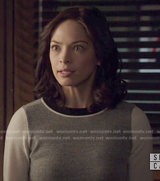 Cat's grey sweater with white sleeves on Beauty and the Beast