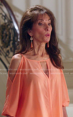 Genevieve's orange cold shoulder top on Devious Maids