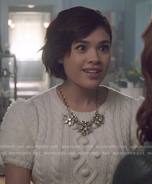 Heather's white short sleeved cable knit sweater on Beauty and the Beast