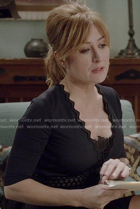 Maura's navy zig zag trim dress on Rizzoli and Isles