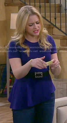 Mel's blue asymmetric peplum top on Melissa and Joey