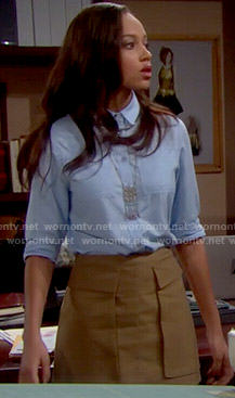 Nicole's blue button front shirt and tan skirt with pockets on The Bold and the Beautiful