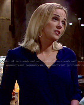 Sage's navy blue lace-sleeve blouse on The Young and the Restless