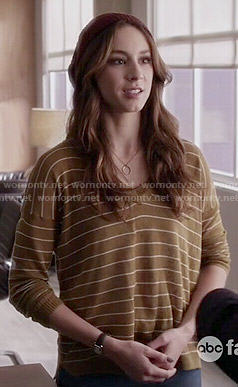Spencer's olive striped sweater on Pretty Little Liars