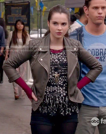 Bay's black and white printed fringed top and leather jacket on Switched at Birth