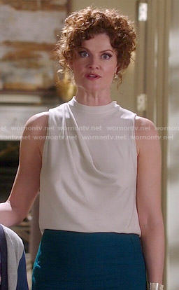 Evelyn's white high-neck draped top on Devious Maids