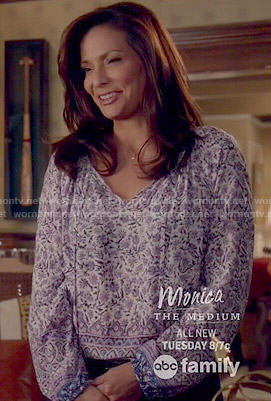 Regina's purple floral blouse on Switched at Birth