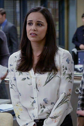 Amy's white floral v-neck blouse on Brooklyn Nine-Nine