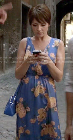April's blue floral wrap dress on Chasing Life