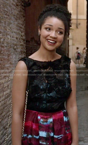Beth's dress with red skirt and black textured top on Chasing Life