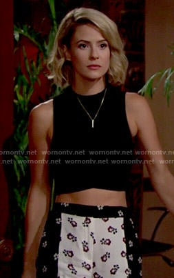Caroline's floral shorts and black crop top on The Young and the Restless