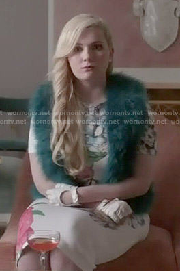 Chanel 5's floral dress and teal fur vest on Scream Queens