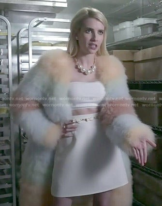 Chanel's rainbow striped fur coat and white crop top and skirt on Scream Queens