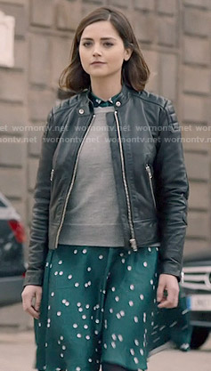 Clara's green polka dot shirtdress, grey sweater and leather jacket on Doctor Who