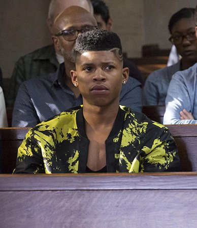 Hakeem's black and yellow printed bomber jacket on Empire