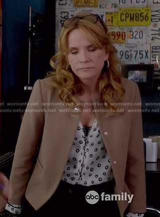 Kathryn's dot printed zip-front top and camel jacket on Switched at Birth