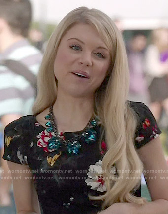 Lauren's black floral cap sleeved dress on Faking It