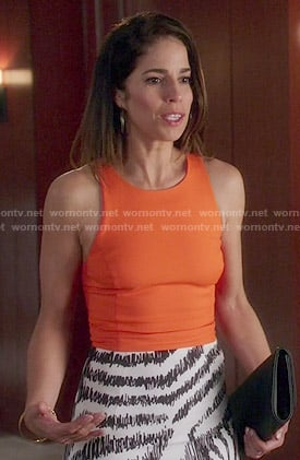 Marisol's orange top and zebra striped skirt on Devious Maids