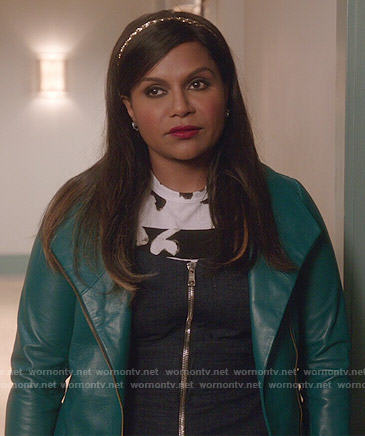 Mindy's zip front denim jumpsuit, painted print tee and teal leather jacket on The Mindy Project