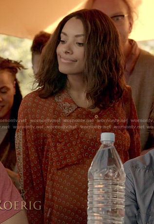 Bonnie's sheer orange printed shirt on The Vampire Diaries