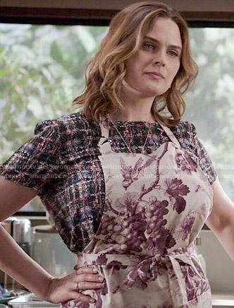Brennan's checked top and grape print apron on Bones