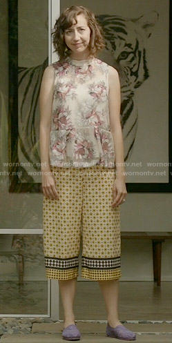 Carol's sheer floral top and yellow printed culottes on Last Man on Earth