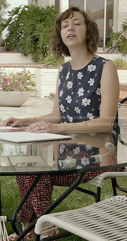 Carol's navy floral sleeveless top on Last Man on Earth