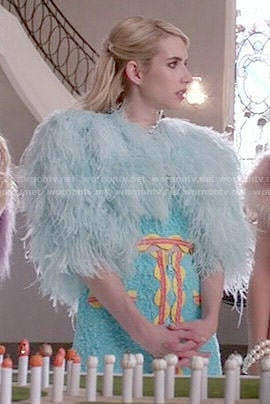 Chanel's turquoise crop top and skirt with orange trim on Scream Queens