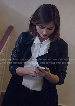 Clara's white scalloped top with zip front and leather sleeve coat on Doctor Who