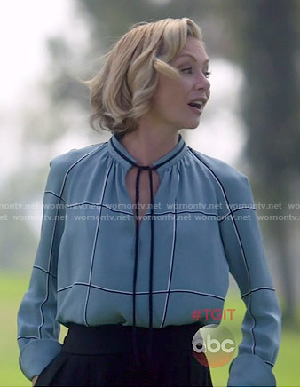 Elizabeth's blue checked tie-neck blouse on Scandal