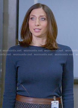 Gina's tweed skirt with leather waistband and blue sweater on Brooklyn Nine-Nine
