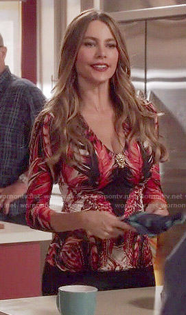 Gloria's red feather print top on Modern Family