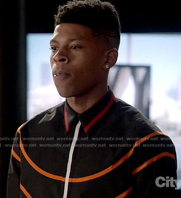 Hakeem's black shirt with orange stripes on Empire