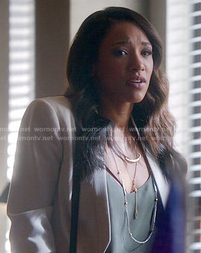 Iris's white cropped jacket and green cami on The Flash