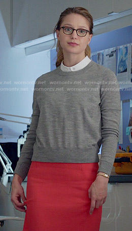 Kara's grey sweater and red pencil skirt on Supergirl