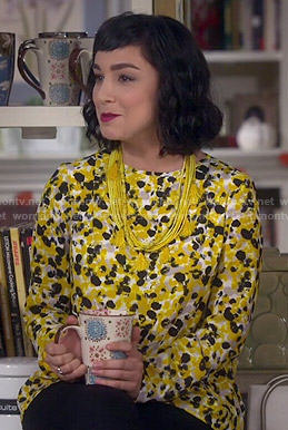 Mandy's yellow printed blouse on Last Man Standing