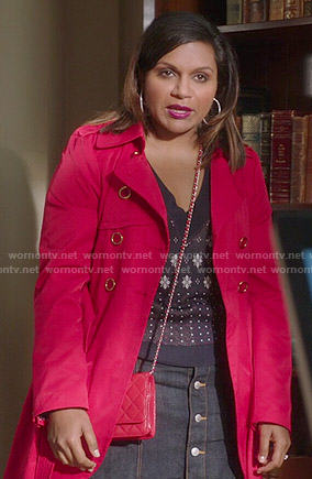 Mindy's navy blue printed v-neck sweater, denim skirt and red coat on The Mindy Project