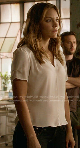 Paige's white split-neck blouse on Scorpion