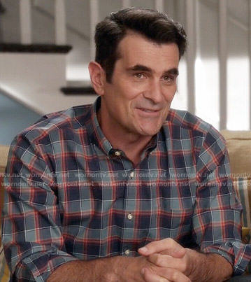 Phil's teal and red plaid shirt on Modern Family