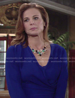 Phyllis's blue wrap top and bib necklace on The Young and the Restless
