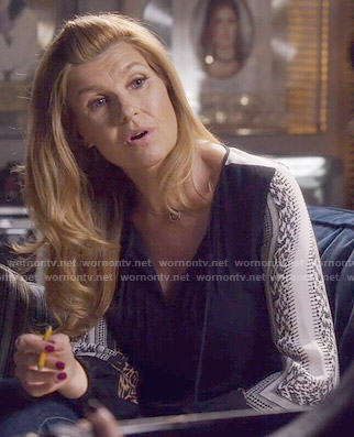 Rayna's black blouse with printed sleeves on Nashville