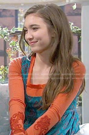 Riley's orange long sleeve top and teal diamond print dress on Girl Meets World