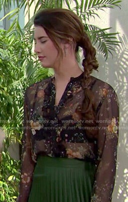 Steffy's sheer floral blouse and green pleated midi skirt on The Bold and the Beautiful