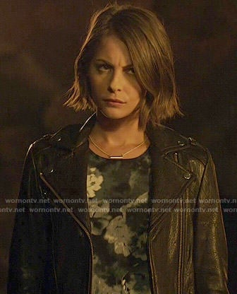 Thea's dark floral top and leather jacket on Arrow