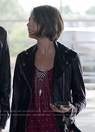 Thea's red printed top and leather jacket on Arrow