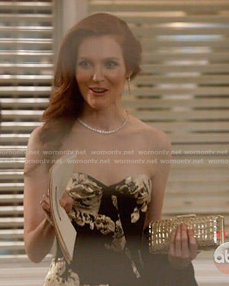 Abby's black and gold strapless gown on Scandal