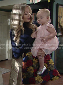 Abby's floral skirt and navy blue turtleneck on The Young and the Restless