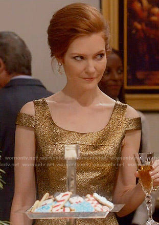 Abby's gold dress with shoulder cutouts on Scandal